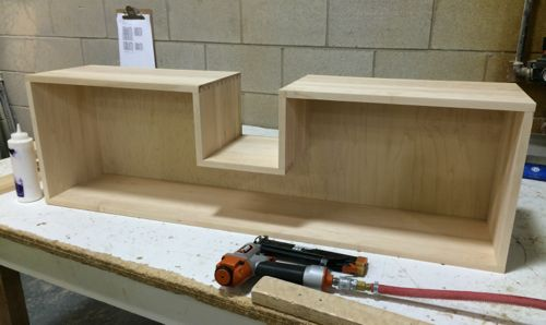 A custom made maple dovetail drawer with a cutout for pipe clearance for use under a sink.