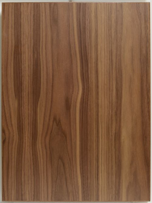 Walnut Flat Cut veneer slab style cabinet door with solid edge.