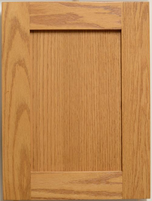 "Allstyle Cabinet Doors - Lancaster shaker style flat panel door in Red Oak. Center panel is flat cut red oak veneer. Panel set back is 9.5mm. Rail width is 57mm (2 1/4""). Edge lip is square (Lip 0). Order code is SHK52-57mm-F1-0 shown in a classic walnut finish code F5486 which is a close match for Formica 5486."