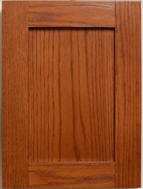 "Allstyle Cabinet Doors - Lancaster shaker style flat panel door in Red Oak. Center panel is flat cut red oak veneer. Panel set back is 9.5mm. Rail width is 57mm (2 1/4""). Edge lip is square (Lip 0). Order code is SHK52-57mm-F1-0 shown in a Glamour Cherry finish code F6208 which is a close match for Formica 6208."