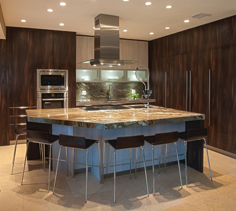 A sleek and modern designed kitchen with two tone using textured laminate. The brown vertical wood grained laminate is S012 Milton.